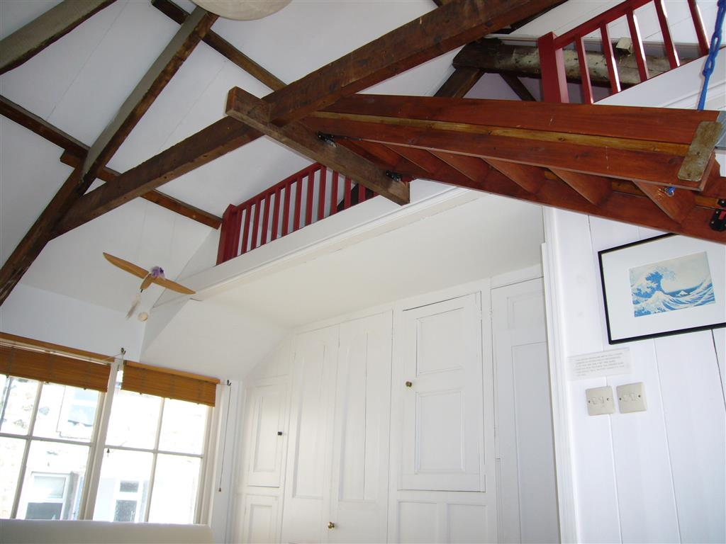 56) Slantways -  High ceiling and attic area over sitting room.