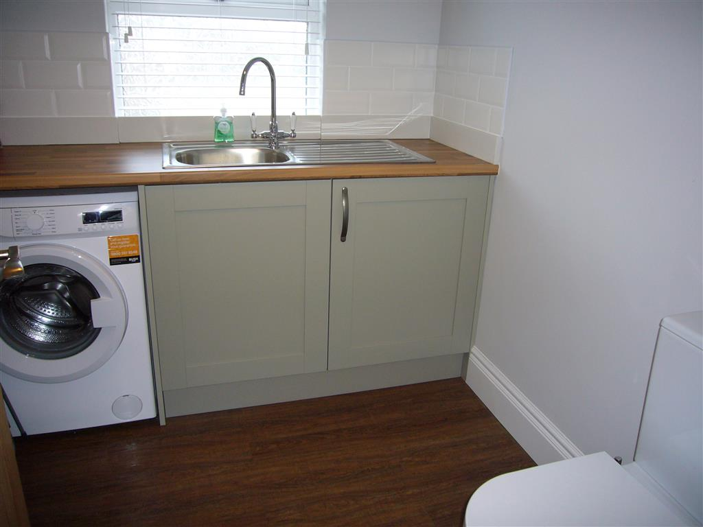 60) 24 Trenwith Place -  Utility room just off kitchen