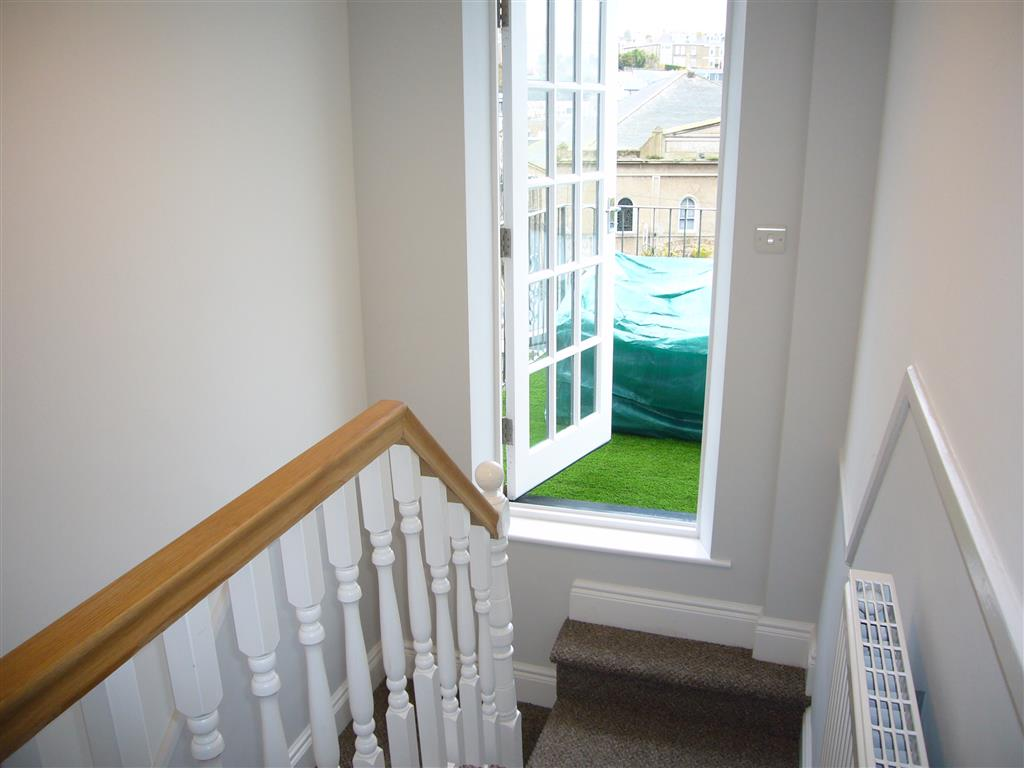 60) 24 Trenwith Place -  Terrace reached from landing up to first floor