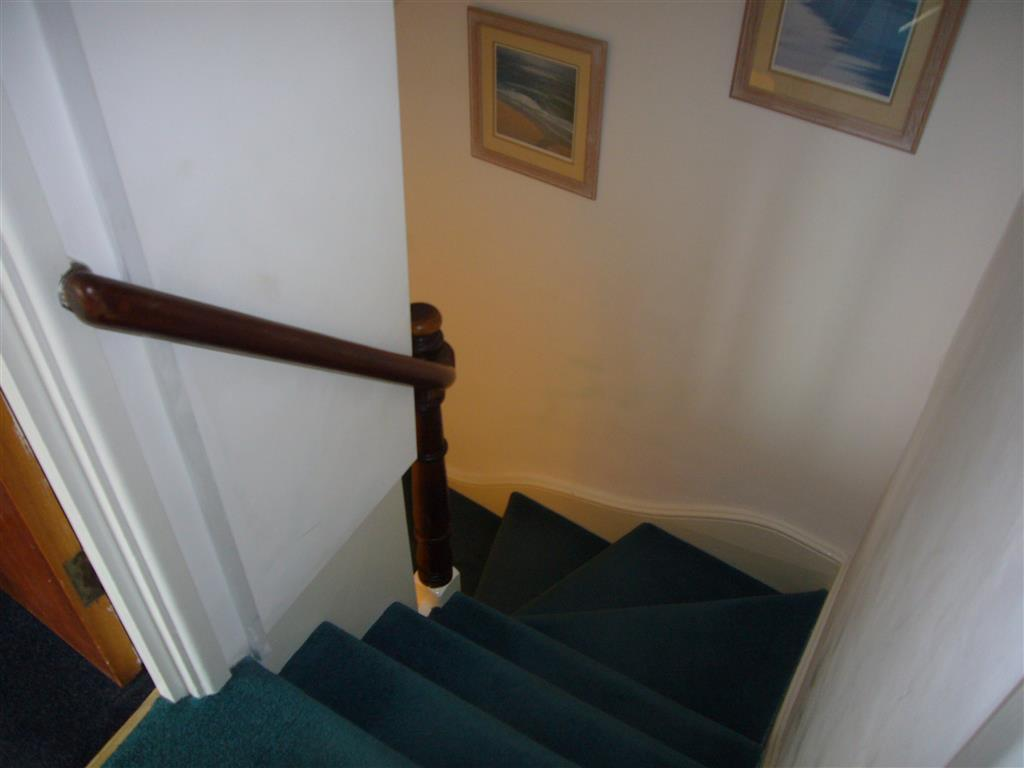 63) Crows Nest -  Stairs down from apartment to apartment door.