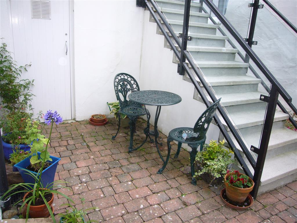 60) 10 Lyonesse -  Courtyard area with bistro set