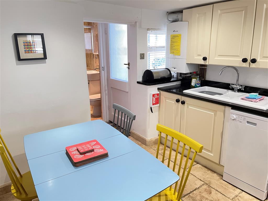 29) Sixpence Cottage -  Top landing looking down to sitting room