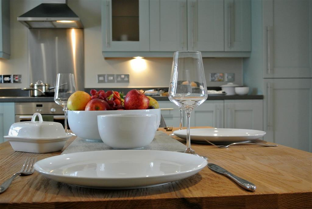 dining table with fruit bowl showing kitchen