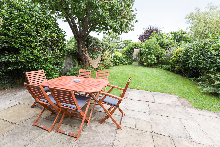 Outside dining table and view of garden